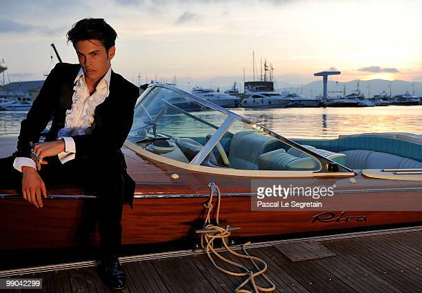 Chanel model Baptiste Giabiconi poses after the Chanel cruise collection show on May 11 2010 in SaintTropez France