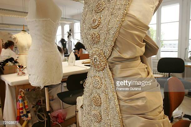 Chanel seamstresses put the final touches to the Chanel Haute Couture FallWinter 2006/07 Fashion collection during Paris Fashion Week in the Chanel...
