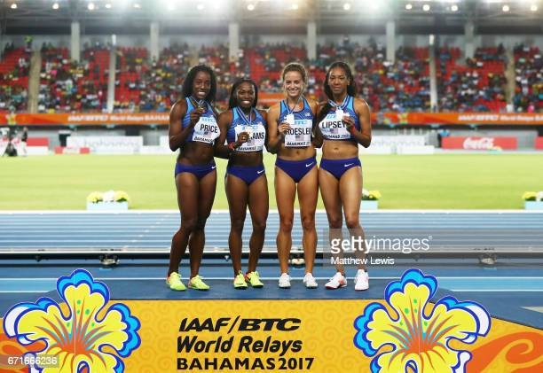 Chanelle Price Chrishuna Williams Laura Roesler and Charlene Lipsey of Team USA pose on the podium after placing first in the Women's 4 x 800 Meters...