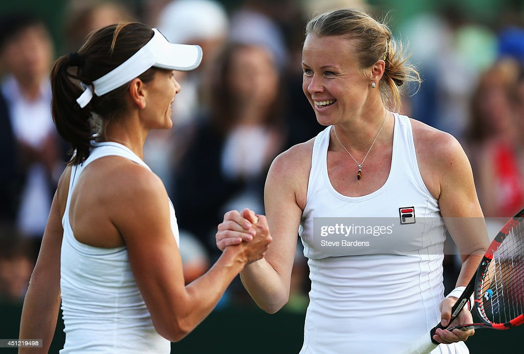 Chanelle Scheepers of South Africa and Vera Dushevina of Russia during their Ladies Doubles first round match against Annika Beck of Germany and...