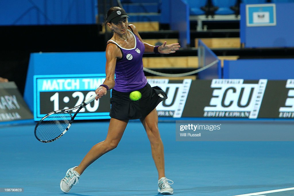 Chanelle Scheepers of South Africa hits a forehand shot in her singles match against Anabel Medina Garrigues of Spain during day one of the Hopman Cup at Perth Arena on December 29, 2012 in Perth, Australia.