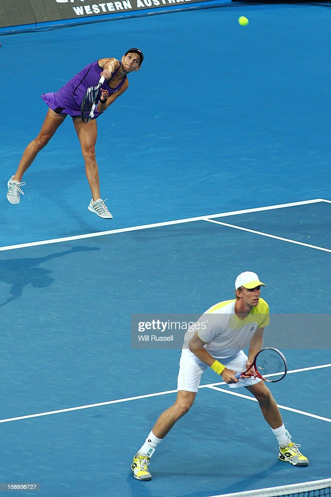 Chanelle Scheepers of South Africa serves as Kevin Anderson looks on during their mixed doubles game against Jo-Wilfried Tsonga and Mathilde Johansson of France during day seven of the Hopman Cup at Perth Arena on January 4, 2013 in Perth, Australia.