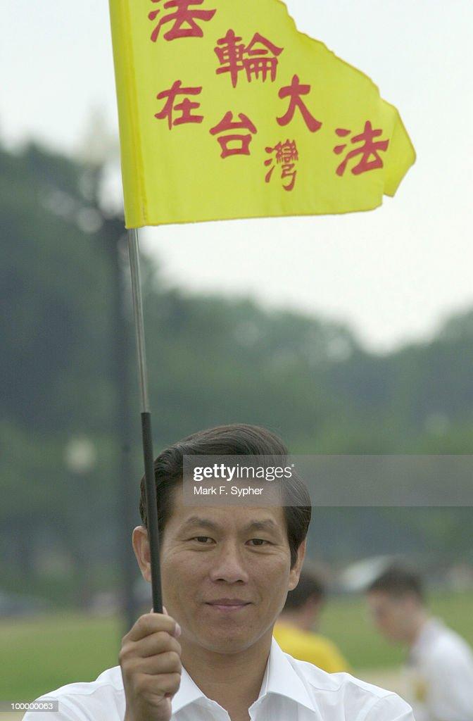Chang Jen Yeu holds a sign that reads 'Falun Dafa' in Taiwaneese. Yeu came from Hualien, Taiwan to join in the Falun Dafa March.