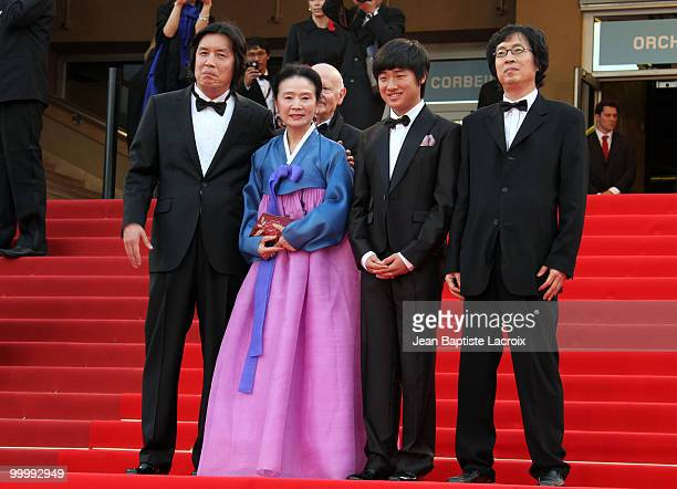 ChangDong Lee Jeonghee Yoon David Lee and Jundong Lee attend the premiere of 'Poetry' held at the Palais des Festivals during the 63rd Annual...