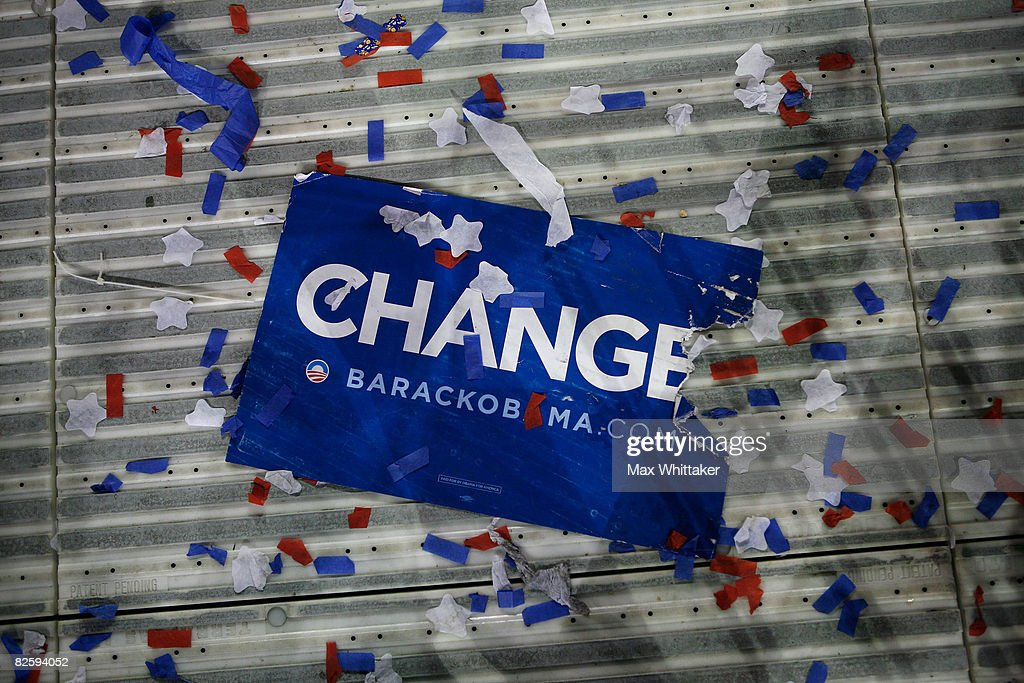 A 'Change' campaign poster for Sen Barack Obama lies on the ground at the end of day four of the Democratic National Convention at Invesco Field at...
