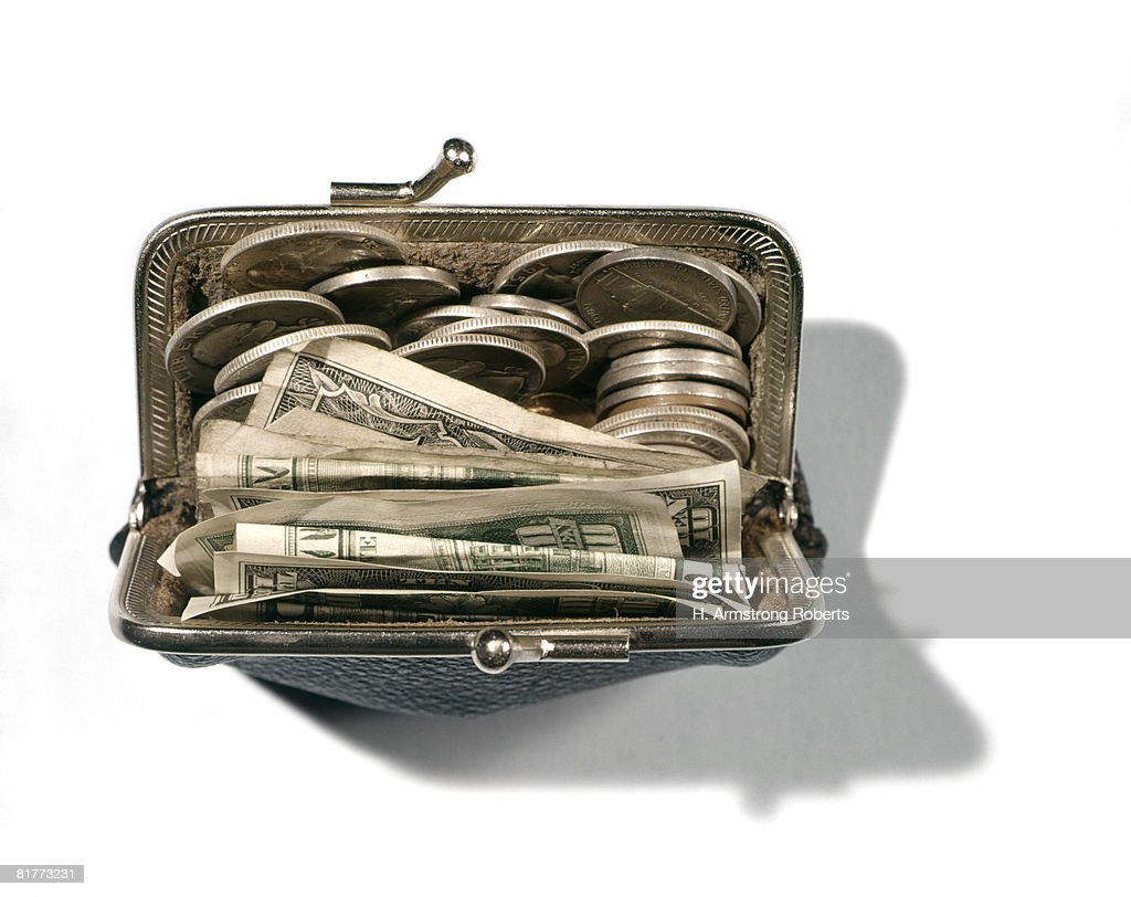 Change Purse With Bills And Coins. : Bildbanksbilder