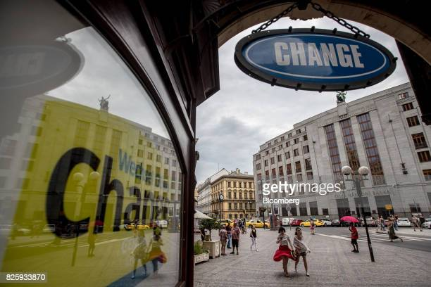 A 'Change' sign hangs on display outside a foreign currency exchange bureau opposite the headquarters of the Czech Central Bank in Prague Czech...