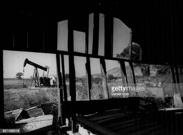 Changing Times are Illustrated by Oil Well Chugging Away Next to Abandoned Farm Shed He shed and well share a plot of ground along Riverdale Road and...
