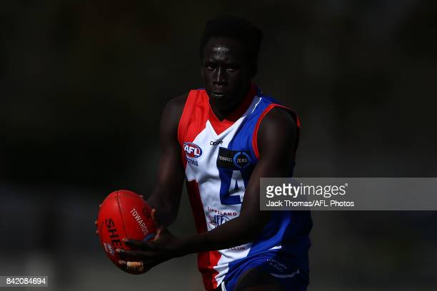 Changkuoth Jiath of the Power looks to handball during the TAC Cup round 18 match between Gippsland and Murray at Victoria Park on September 3 2017...