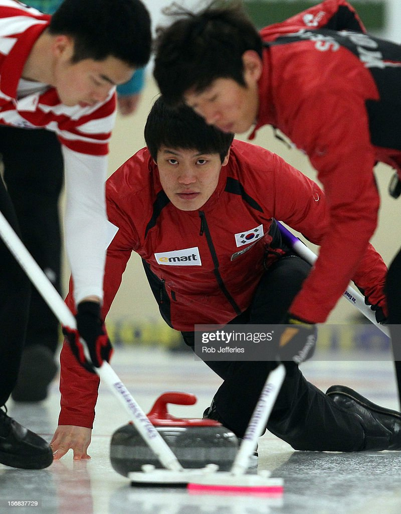 Chang-Min Kim of Korea delivers a stone during the Pacific Asia 2012 Curling Championship at the Naseby Indoor Curling Arena on November 23, 2012 in Naseby, New Zealand.
