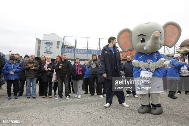 Changy the Elephant holds a fundraising bucket as Everton fans enjoy the atmosphere in the Everton Roadshow outside Goodison Park before kickoff