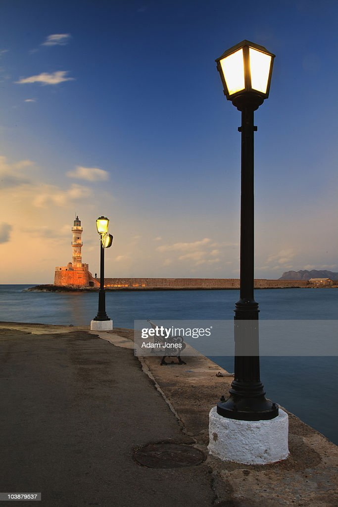 Chania Harbor and Venetian lighthouse at sunset : Stock Photo
