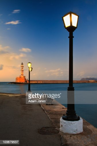 Chania Harbor and Venetian lighthouse at sunset : ストックフォト