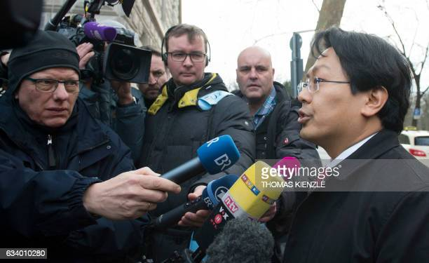 Chanjo Jun lawyer of Syrian refugee Anas Modamani talks to the media on his way to the district court in Wuerzburg southern Germany on February 6...