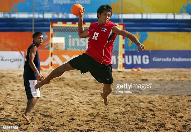 Channarong Hunvun of Thailand shoots on goal during their beach handball match against Japan on day four of the 2008 Asian Beach Games at Sanur Beach...