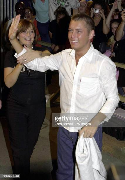 Channel 4's Big Brother hostess Davina McCall escorts Brian from the Big Brother house to claim the 70000 prize