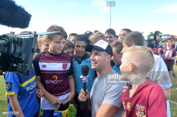 Channel 9 personality and former Rugby League player Beau Ryan chats with chidren at a Junior Rugby League Clinic during a Queensland Maroons State...
