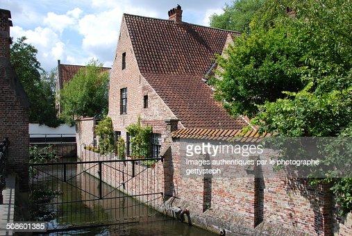 Channel along a house : Foto de stock