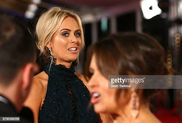 Channel Nine presenters Sylvia Jeffreys looks towards Lisa Wilkinson as they arrive at the 58th Annual Logie Awards at Crown Palladium on May 8 2016...