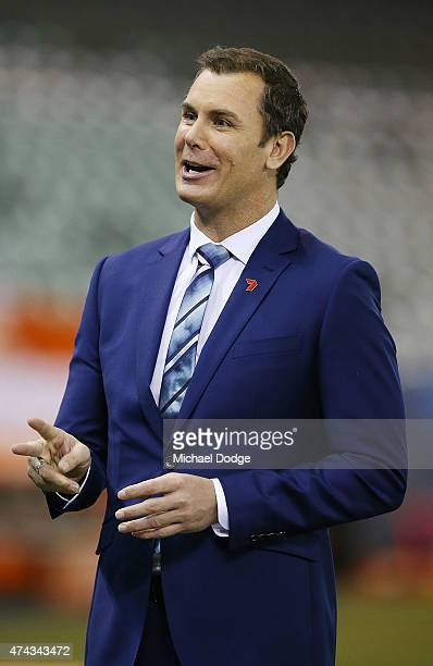 Channel Seven football commentator Wayne Carey speaks to camera during the round eight AFL match between the Geelong Cats and the Carlton Blues at...