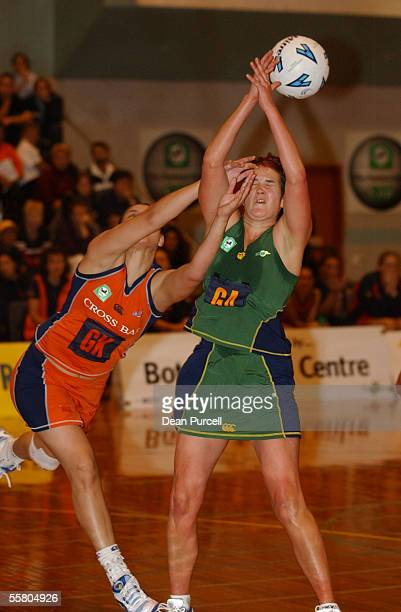 Channelle Lundon of the Cometz hits Charissa Wilson of the Flyers in the face as she trys to get the ball during round 2 of The National Bank Netball...
