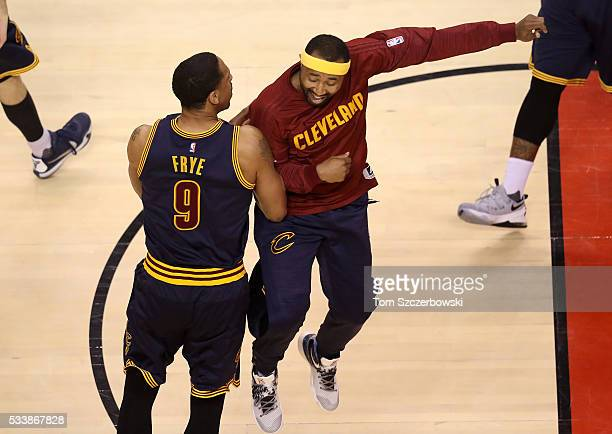 Channing Frye and Mo Williams of the Cleveland Cavaliers react in the second half against the Toronto Raptors in game four of the Eastern Conference...