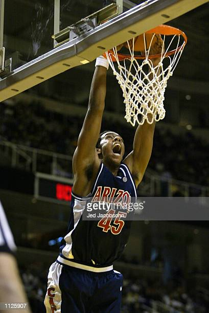 Channing Frye of the Arizona Wildcats slam dunks during the West Regional Semifinal of the 2002 NCAA Basketball Tournament against the Oklahoma...