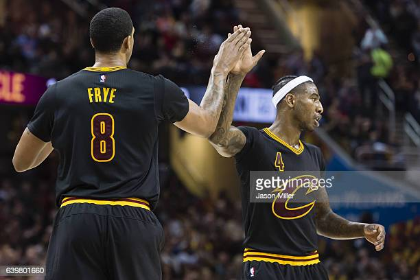 Channing Frye of the Cleveland Cavaliers and Iman Shumpert celebrate after scoring during the first half against the San Antonio Spurs at Quicken...