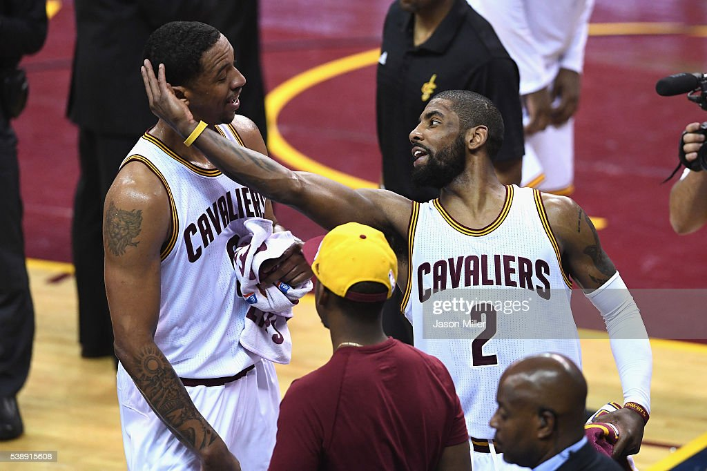 Channing Frye #9 of the Cleveland Cavaliers and Kyrie Irving #2 react during the second half against the Golden State Warriors in Game 3 of the 2016 NBA Finals at Quicken Loans Arena on June 8, 2016 in Cleveland, Ohio.