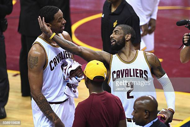 Channing Frye of the Cleveland Cavaliers and Kyrie Irving react during the second half against the Golden State Warriors in Game 3 of the 2016 NBA...