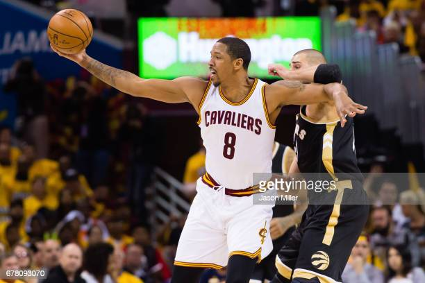 Channing Frye of the Cleveland Cavaliers catches a pass while under pressure from Jonas Valanciunas of the Toronto Raptors during the first half of...