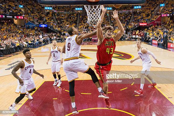 Channing Frye of the Cleveland Cavaliers fouls Kris Humphries of the Atlanta Hawks the NBA Eastern Conference semifinals at Quicken Loans Arena on...