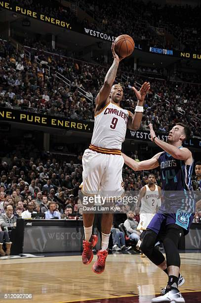 Channing Frye of the Cleveland Cavaliers shoots against Frank Kaminsky III of the Charlotte Hornets on February 24 2016 at Quicken Loans Arena in...