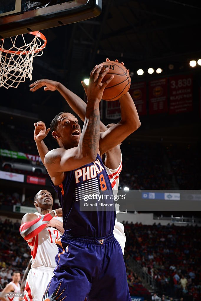 <a gi-track='captionPersonalityLinkClicked' href=/galleries/search?phrase=Channing+Frye&family=editorial&specificpeople=206815 ng-click='$event.stopPropagation()'>Channing Frye</a> #8 of the Phoenix Suns drives to the basket against the Houston Rockets on December 4, 2013 at the Toyota Center in Houston, Texas.