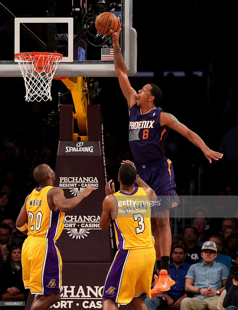 Channing Frye #8 of the Phoenix Suns dunks over Shawne Williams #3 and Jodie Meeks #20 of the Los Angeles Lakers at Staples Center on December 10, 2013 in Los Angeles, California. The Suns 2on 114-108.