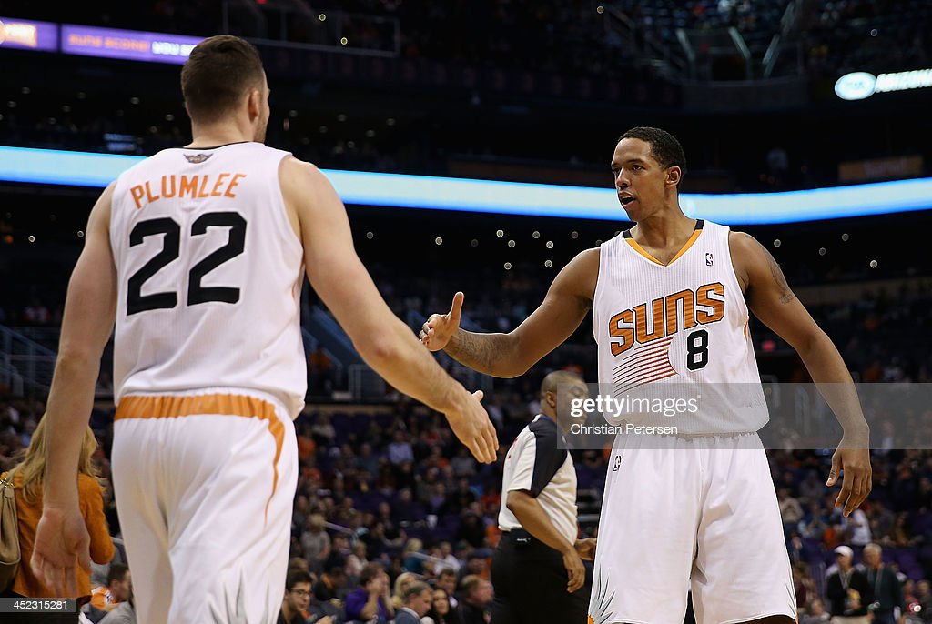 Channing Frye #8 of the Phoenix Suns high-fives Miles Plumlee #22 after scoring against the Portland Trail Blazers during the second half of the NBA game at US Airways Center on November 27, 2013 in Phoenix, Arizona. The Suns defeated the Trail Blazers 120-106.