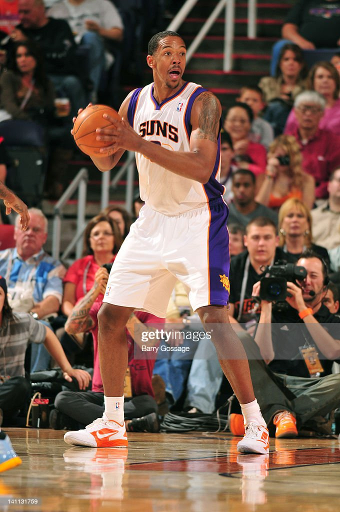 <a gi-track='captionPersonalityLinkClicked' href=/galleries/search?phrase=Channing+Frye&family=editorial&specificpeople=206815 ng-click='$event.stopPropagation()'>Channing Frye</a> #8 of the Phoenix Suns looks for a teammate to pass to against the Memphis Grizzlies in an NBA game played on March 10, 2012 at U.S. Airways Center in Phoenix, Arizona.