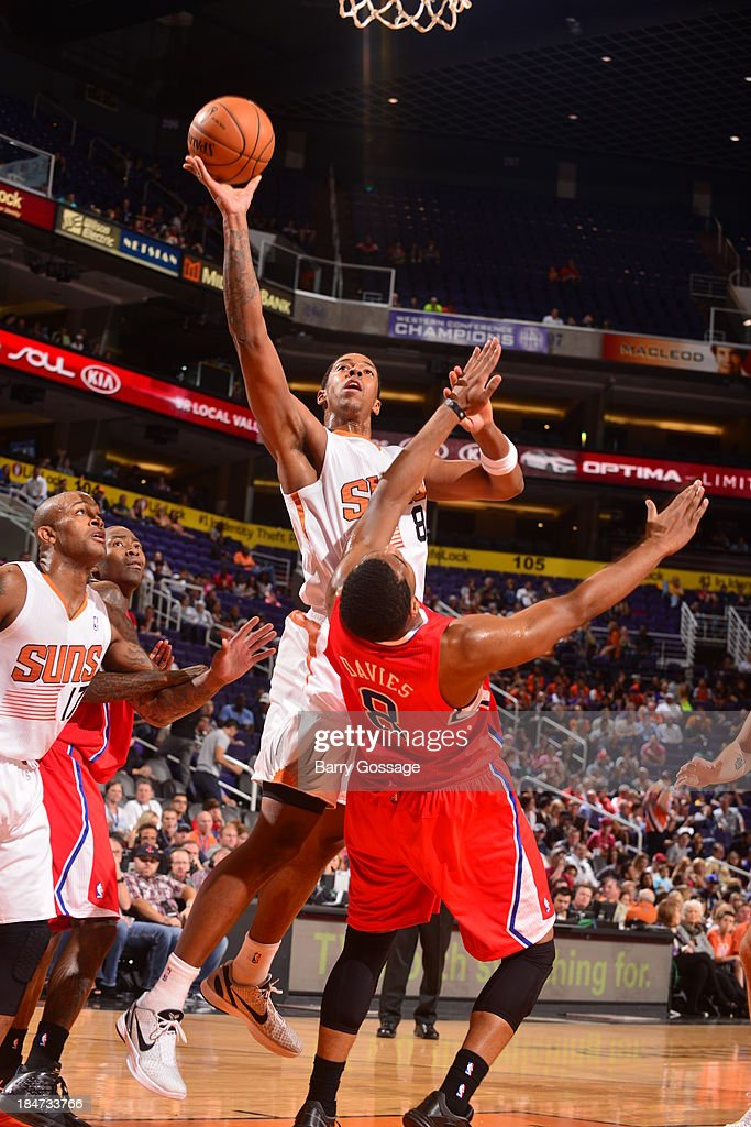 <a gi-track='captionPersonalityLinkClicked' href=/galleries/search?phrase=Channing+Frye&family=editorial&specificpeople=206815 ng-click='$event.stopPropagation()'>Channing Frye</a> #8 of the Phoenix Suns shoots against Brandon Davies #8 of the Los Angeles Clipper on October 15, 2013 at U.S. Airways Center in Phoenix, Arizona.