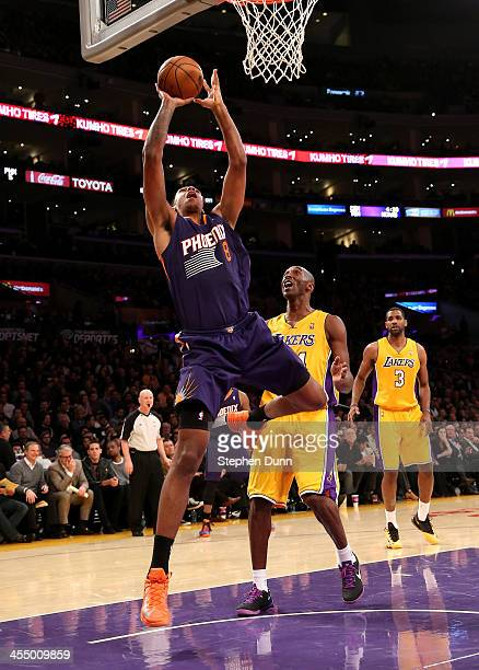 Channing Frye of the Phoenix Suns shoots over Kobe Bryant of the Los Angeles Lakers at Staples Center on December 10 2013 in Los Angeles California...