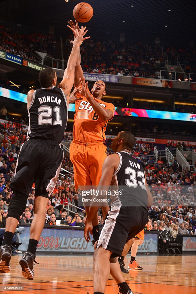 Channing Frye #8 of the Phoenix Suns shoots over Tim Duncan #21 of the San Antonio Spurs on February 21, 2014 at U.S. Airways Center in Phoenix, Arizona.