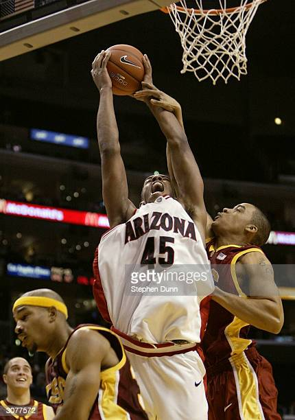 Channing Fyre of the Arizona Wildcats goes to the basket against Nick Curtis of the USC Trojans during the quarterfinals of the 2004 Pacific Life...