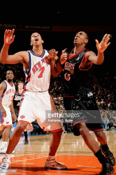 Channing Fyre of the New York Knicks and Steven Hunter of the Philadelphia 76ers battle for position under the basket during the game at the Madison...