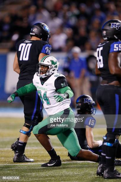 Channing Hames of the Marshall Thundering Herd reacts after sacking the quarterback in the first quarter of a game against the Middle Tennessee Blue...