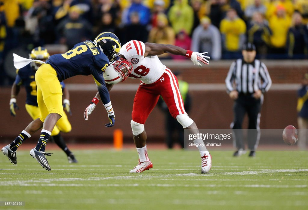 Channing Stribling #8 of the Michigan Wolverines and Quincy Enunwa #18 of the Nebraska Cornhuskers collide during the second quarter at Michigan Stadium on November 9, 2013 in Ann Arbor, Michigan.