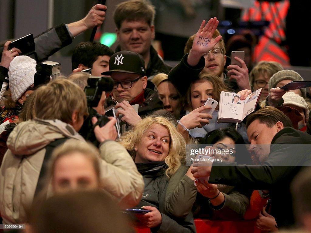 Channing Tatum (R) poses for a photo with the fans as he attends the 'Hail, Caesar!' premiere during the 66th Berlinale International Film Festival Berlin at Berlinale Palace in Berlin, Germany on February 11, 2016.