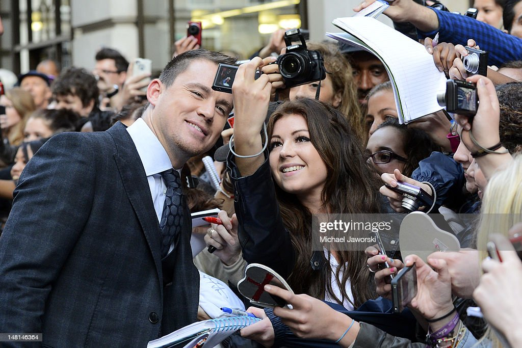 Channing Tatum poses with fans outside the Mayfair Hotel ahead of the European Premiere of Magic Mike on July 10, 2012 in London, England.