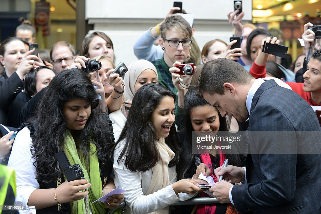 Channing Tatum signs autographs outside the Mayfair Hotel ahead of the European Premiere of Magic Mike on July 10, 2012 in London, England.