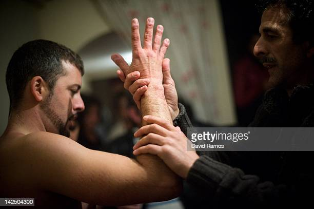 Chano massage the arms of his son Feliciano Isaac aged 31 for recovrering the circulation of the blood after walking the way of the cross or 'Via...