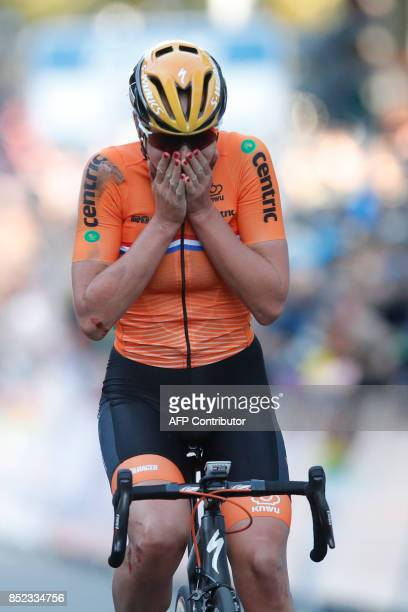 Chantal Blaak of the Netherlands reacts after crossing the finish line first during the UCI Cycling Road World Championships Women's Road Race in...