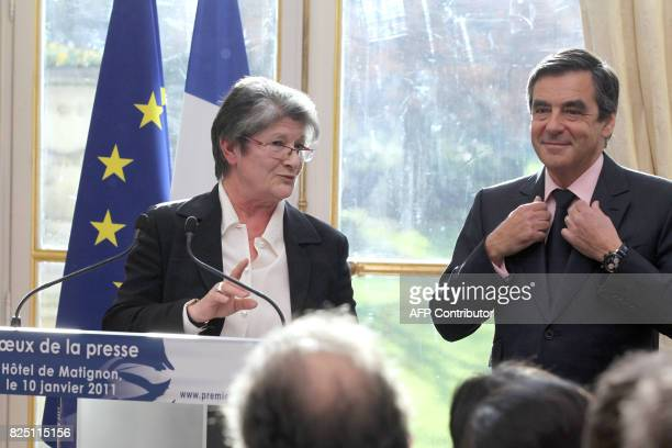 Chantal Didier President of the association of Ministries Press flanked by France's Prime Minister Francois Fillon speaks during the New Year wishes...